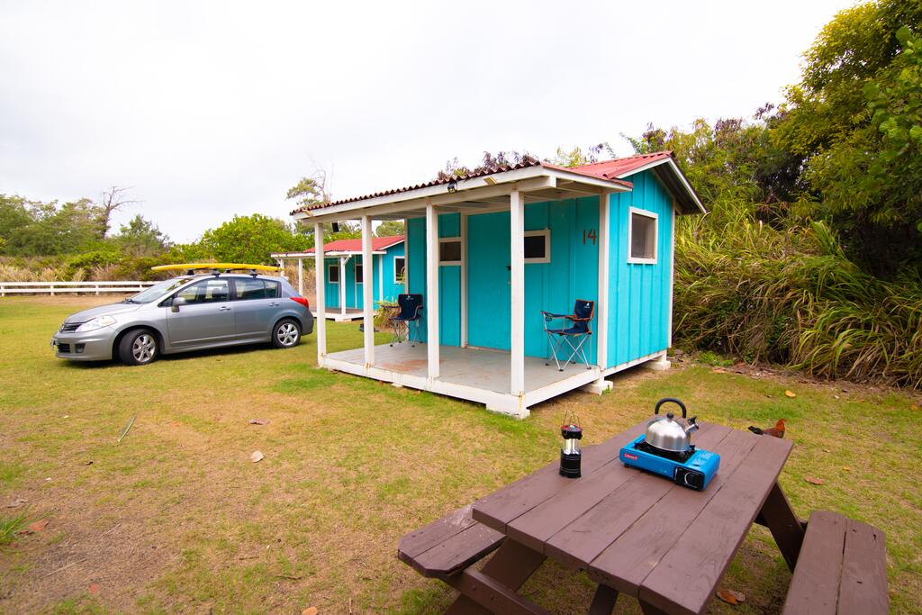 Scenic beachfront campground with plantation-style huts